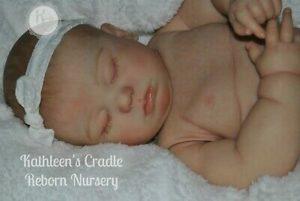 June asleep reborn baby